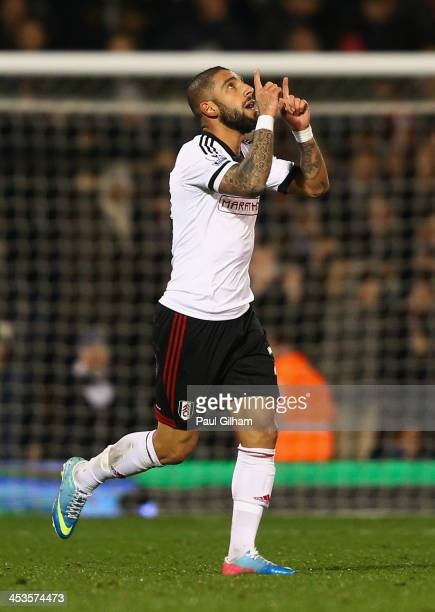 Ashkan Dejagah of Fulham celebrates as he scores their first goal during the Barclays Premier League match between Fulham and Tottenham Hotspur at...