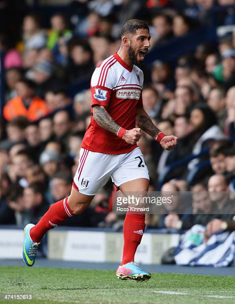 Ashkan Dejagah of Fulham celebrates as he scores their first goal during the Barclays Premier League match between West Bromwich Albion and Fulham at...