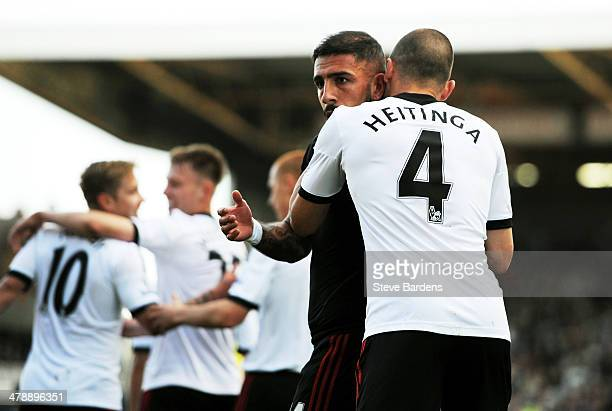 Ashkan Dejagah of Fulham celebrates with teammate John Heitinga after scoring the opening goal during the Barclays Premier league match between...
