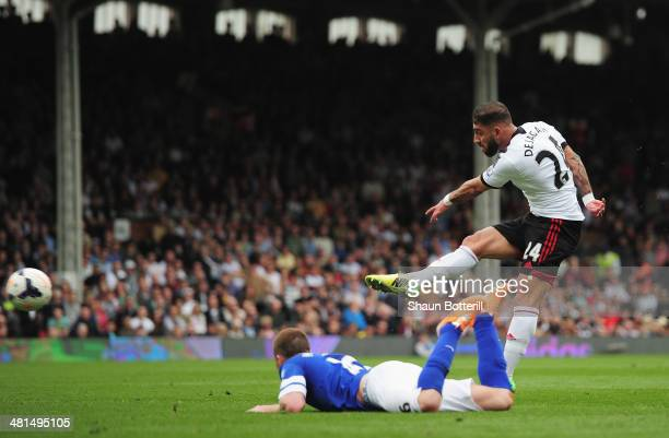 Ashkan Dejagah of Fulham scores his team's first goal during the Barclays Premier League match between Fulham and Everton at Craven Cottage on March...