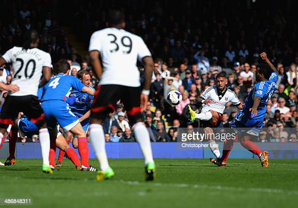 Ashkan Dejagah of Fulham scores their first goal during the Barclays Premier League match bewteen Fulham and Hull City at Craven Cottage on April 26...