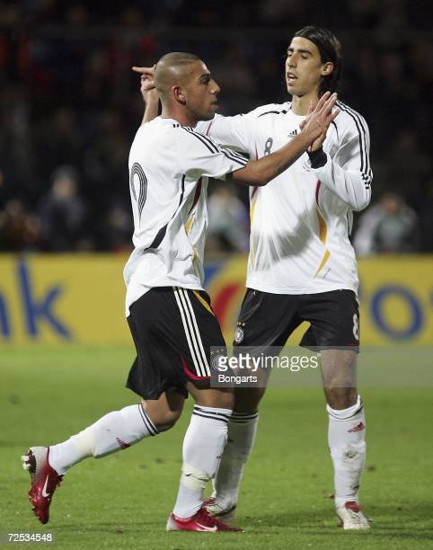 Ashkan Dejagah of Germany celebrates his goal with his teammate Sami Khedira during the Men's U20 international friendly match between Germany and...