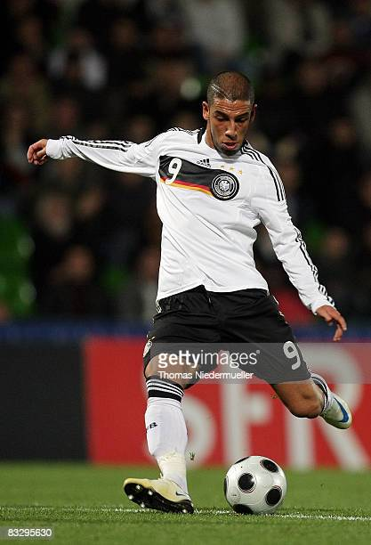 Ashkan Dejagah of Germany strikes the ball during the UEFA U21 Championship Playoff match between France and Germany at the Stade Saint Symphorien on...