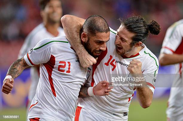 Ashkan Dejagah of Iran celebrate his goal with team mate Anderanik Teymourian during their 2015 Asian Cup group B qualifying football match at...