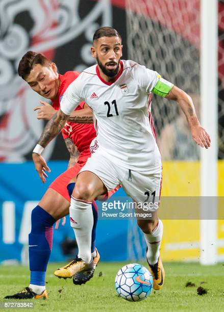 Ashkan Dejagah of Iran fights for the ball with Jang Hyunsoo of Korea Republic during their 2018 FIFA World Cup Russia Final Qualification Round...