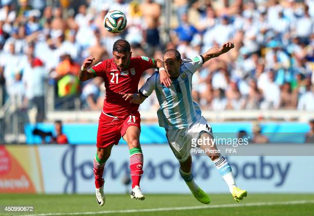 Ashkan Dejagah of Iran heads the ball during the 2014 FIFA World Cup Brazil Group F match between Argentina and Iran at Estadio Mineirao on June 21...