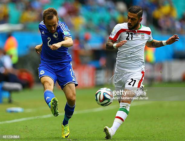 Ashkan Dejagah of Iran in action against Avdija Vrsajevic during the 2014 FIFA World Cup Brazil Group F match between Bosnia and Herzegovina and Iran...
