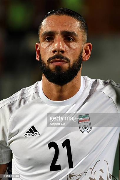 Ashkan Dejagah of Iran respects his national anthem before kick off during the 2018 FIFA World Cup Qualifier match between Iran and Syria at Tuanku...