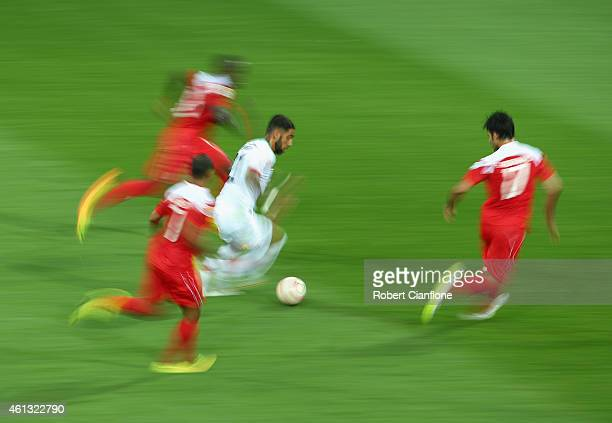 Ashkan Dejagah of Iran runs with the ball during the 2015 Asian Cup match between IR Iran and Bahrain at AAMI Park on January 11 2015 in Melbourne...