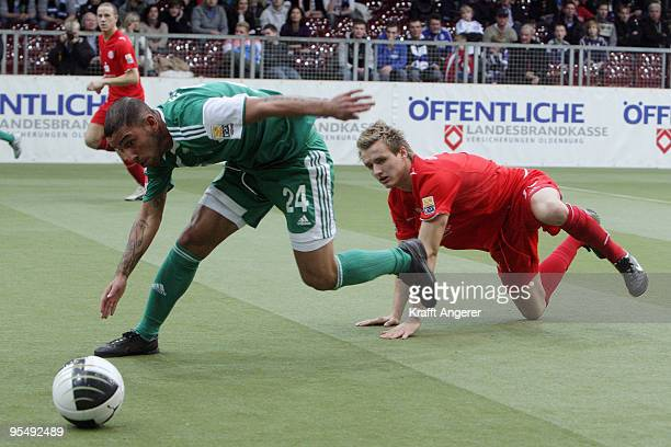 Ashkan Dejagah of Wolfsburg and Claus Costa of Duesseldorf battle for the ball during the Indoor Football Cup match between VFL Wolfsburg and Fortuna...