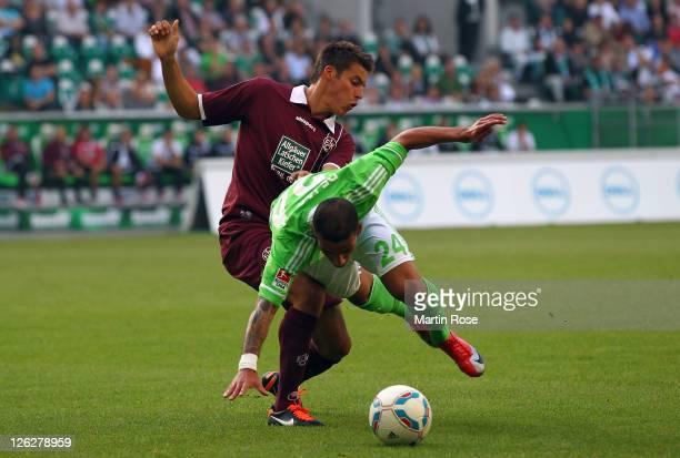Ashkan Dejagah of Wolfsburg and Clemens Walch of Kaiserslautern battle for the ball during the Bundesliga match between VfL Wolfsburg and 1 FC...