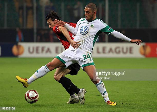 Ashkan Dejagah of Wolfsburg and Simon Davies of Fulham compete for the ball during the UEFA Europa League quarter final second leg match between VfL...