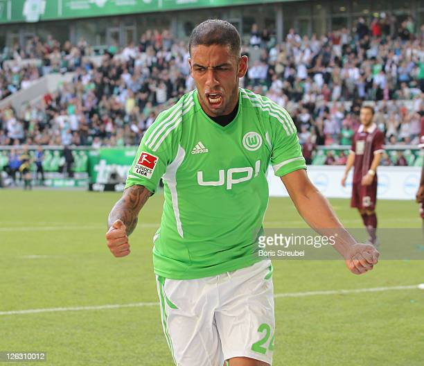 Ashkan Dejagah of Wolfsburg celebrates after he scores his team's first goal during the Bundesliga match between VfL Wolfsburg and 1 FC...