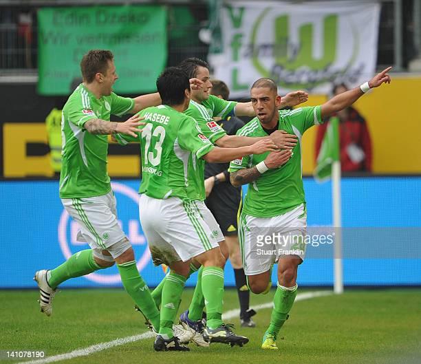 Ashkan Dejagah of Wolfsburg celebrates scoring his goal with teamates during the Bundesliga match between VfL Wolfsburg and Bayer 04 Leverkusen at...