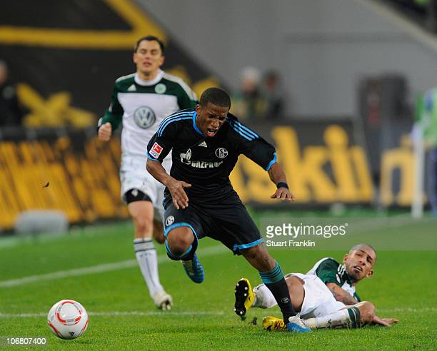Ashkan Dejagah of Wolfsburg challenges Jefferson Farfan of Schalke leading to his red card during the Bundesliga match between VfL Wolfsburg and FC...