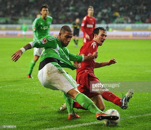 Ashkan Dejagah of Wolfsburg is challenged by Christian Eichner of Koeln during the Bundesliga match between VfL Wolfsburg and 1 FC Koeln at...