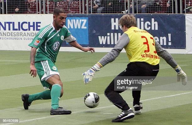 Ashkan Dejagah of Wolfsburg shoots against goalkeeper Maximilian Niehues of Duesseldorf during the Indoor Football Cup match between VFL Wolfsburg...