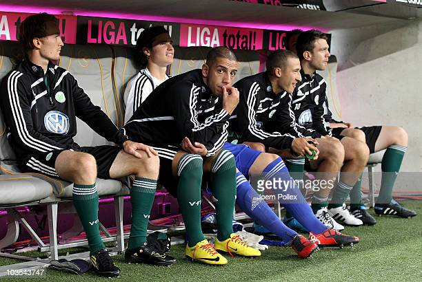 Ashkan Dejagah of Wolfsburg sits on the bench prior to the Bundesliga match between FC Bayern Muenchen and VfL Wolfsburg at Allianz Arena on August...