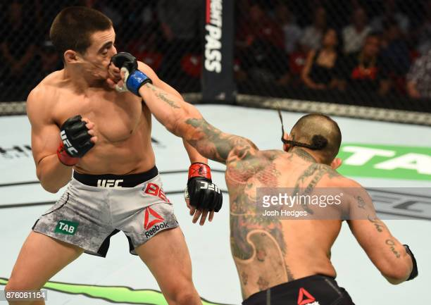 Ashkan Mokhtarian of Iran punches Ryan Benoit in their flyweight bout during the UFC Fight Night event inside the Qudos Bank Arena on November 19,...