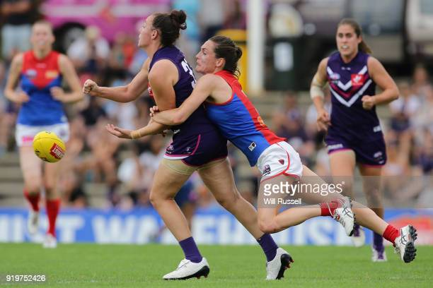Ashlee Atkins of the Dockers is tackled by Meg Downie of the Demons during the round three AFLW match between the Fremantle Dockers and the Melbourne...