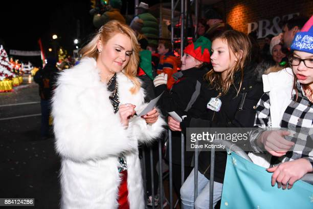 Ashlee Keating sign autographs at the debut TV performance of 'This Christmas Wish' at the West Chester PA Christmas Parade on QVC on December 1 2017...