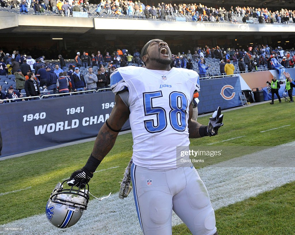 Ashlee Palmer #58 of the Detroit Lions reacts after the Lions victory against the Chicago Bears on November 10, 2013 at Soldier Field in Chicago, Illinois. The Detroit Lions defeated the Chicago Bears 21-19.