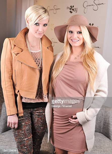 Ashlee Simpson and Jessica Simpson visit The Bay to promote their new tween line for girls 'Jessica Simpson Girls' at The Bay on December 3 2011 in...