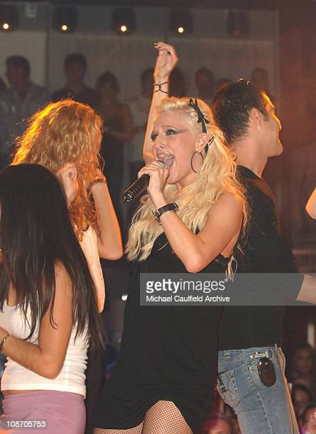 Ashlee Simpson performs at PURE Nightclub with some of her friends