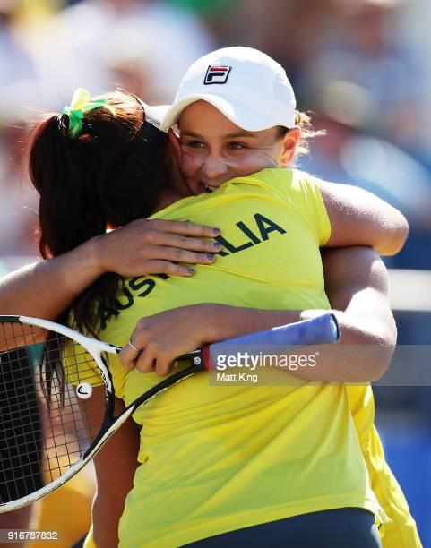 Ashleigh Barty and Casey Dellacqua of Australia celebrate victory in the doubles match against Lyudmyla Kichenok and Nadiia Kichenok of Ukraine...