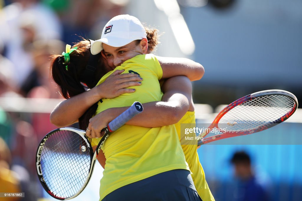 Ashleigh Barty (R) and Casey Dellacqua (L) of Australia celebrate victory in the doubles match against Lyudmyla Kichenok and Nadiia Kichenok of Ukraine during the Fed Cup tie between Australia and the Ukraine at the Canberra Tennis Centre on February 11, 2018 in Canberra, Australia.
