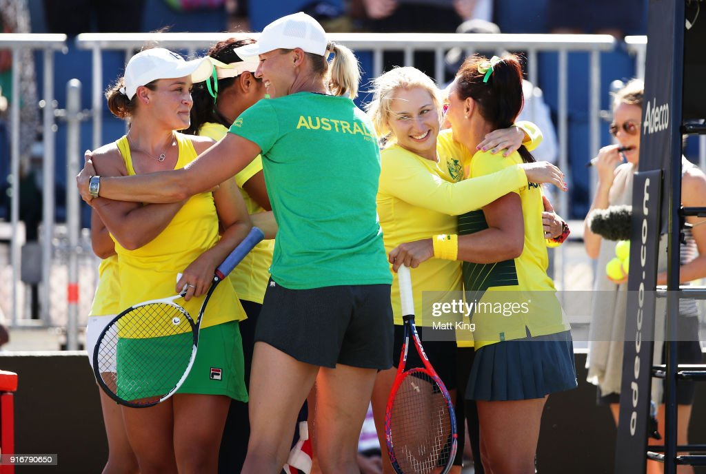 Ashleigh Barty (L) and Casey Dellacqua (R) of Australia celebrate victory with team mates in the doubles match against Lyudmyla Kichenok and Nadiia Kichenok of Ukraine during the Fed Cup tie between Australia and the Ukraine at the Canberra Tennis Centre on February 11, 2018 in Canberra, Australia.