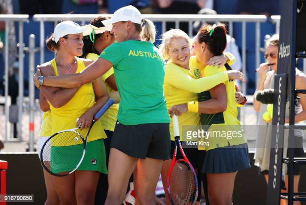 Ashleigh Barty and Casey Dellacqua of Australia celebrate victory with team mates in the doubles match against Lyudmyla Kichenok and Nadiia Kichenok...