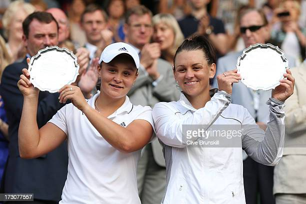 Ashleigh Barty and Casey Dellacqua of Australia smile as they pose with the runnersup trophies after their Ladies' Doubles final match against Shuai...