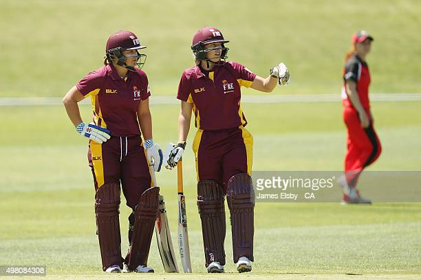 Ashleigh Barty and De Kimmince of the Fire chat during the WNCL match between South Australia and Queensland at Railsways Oval on November 21 2015 in...