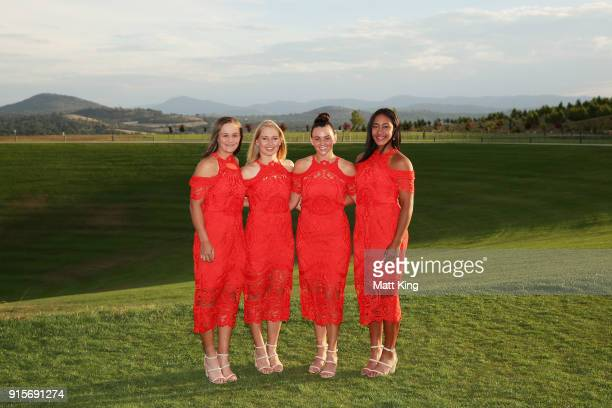 Ashleigh Barty Daria Gavrilova Casey Dellacqua and Destanee Aiava of Australia pose during the Official Dinner ahead of the Fed Cup tie between...