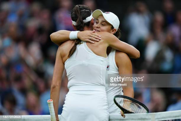 Ashleigh Barty of Australia and Ajla Tomljanovic of Australia embrace at the net after their Ladies' Singles Quarter-Final match during Day Eight of...