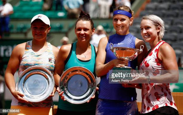 Ashleigh Barty of Australia and Casey Dellacqua of Australia hold their runners up trophies and Lucie Safarova of The Czech Republic and Bethanie...