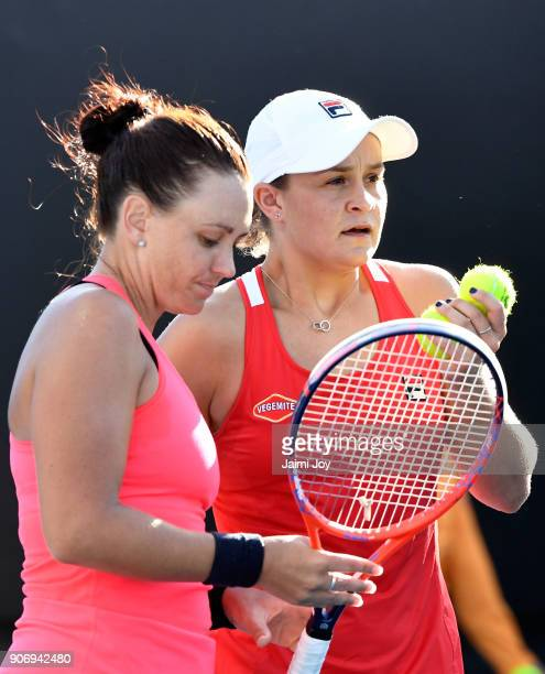 Ashleigh Barty of Australia and Casey Dellacqua talk tactics in their first round women's doubles match against Elise Mertens of Belgium and Demi...