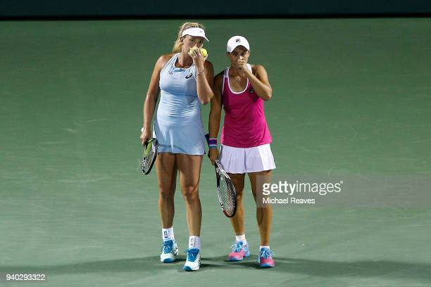 Ashleigh Barty of Australia and CoCo Vandeweghe of the United States talk before serving to Ekaterina Makarova and Elena Vesnina of Russia during...