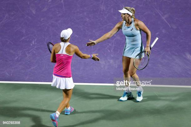 Ashleigh Barty of Australia and CoCo Vandeweghe of the United States react after a point against Ekaterina Makarova and Elena Vesnina of Russia...