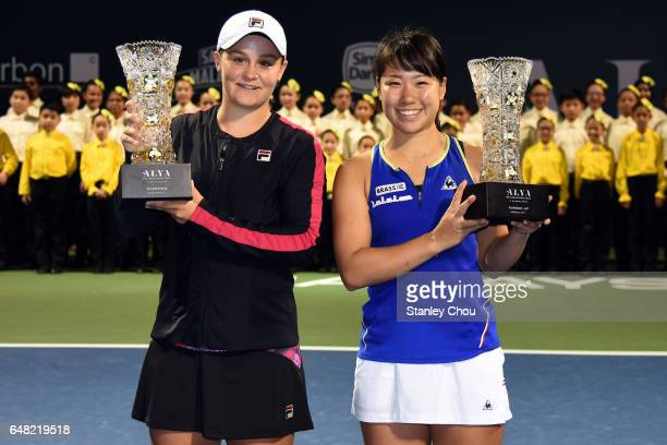 Ashleigh Barty of Australia and Nao Hibino of Japan poses with their respective WTA Malaysian Open Trophies during the Final of the 2017 WTA...