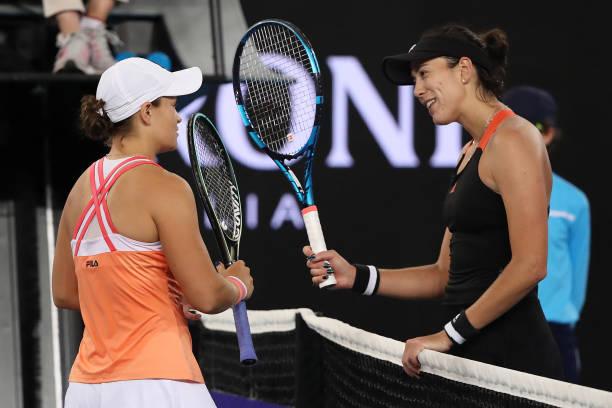 Ashleigh Barty of Australia bumps rackets with Garbine Muguruza of Spain after winning the Women's SinglesFinal match during day eight of the WTA...