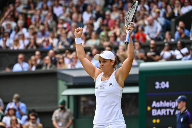 Ashleigh Barty of Australia celebrates her victory over Angelique Kerber of Germany in the semi-finals of the ladies singles during Day Ten of The...