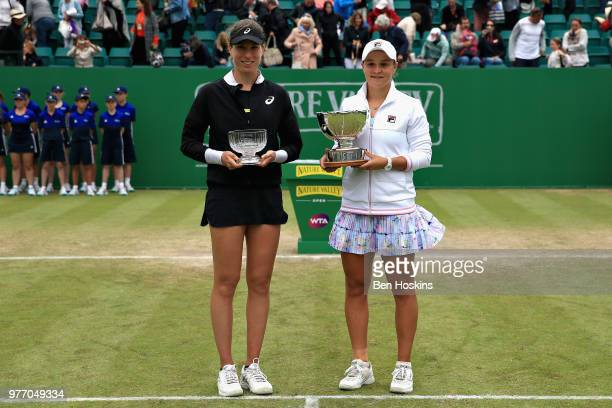 Ashleigh Barty of Australia celebrates victory with runner up Johanna Konta of Great Britain in the Womens Singles Final during Day Nine of the...