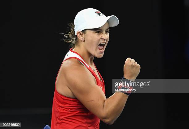 Ashleigh Barty of Australia celebrates winning her first round match against Aryna Sabalenka of Belarus on day two of the 2018 Australian Open at...