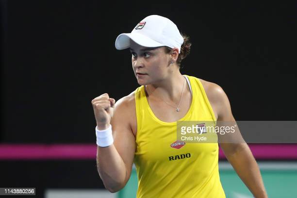 Ashleigh Barty of Australia celebrates winning her match against Victoria Azarenka of Belarus during the Fed Cup World Group Semi Final Australia v...