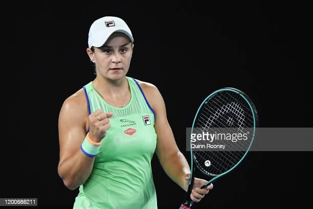 Ashleigh Barty of Australia celebrates winning match point during her Women's Singles first round match against Lesia Tsurenko of Ukraine on day one...