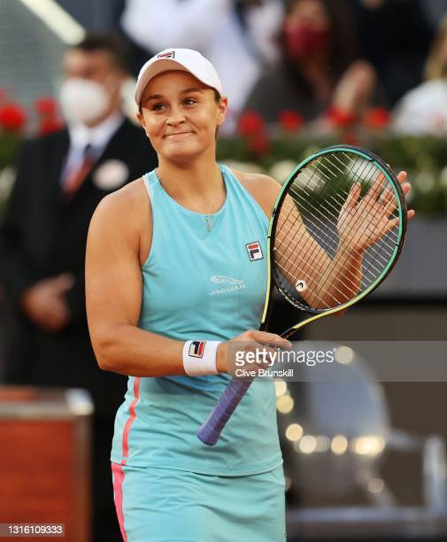 Ashleigh Barty of Australia celebrates winning match point during her match against Iga Swiatek of Poland at La Caja Magica on May 03, 2021 in...