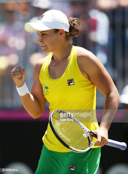 Ashleigh Barty of Australia celebrates winning match point in her singles match against Lyudmyla Kichenok of Ukraine during the Fed Cup tie between...