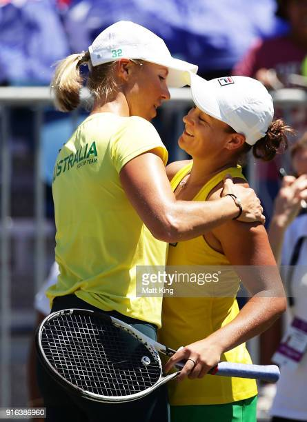Ashleigh Barty of Australia celebrates with Australia captain Alicia Molik after winning match point in her singles match against Lyudmyla Kichenok...